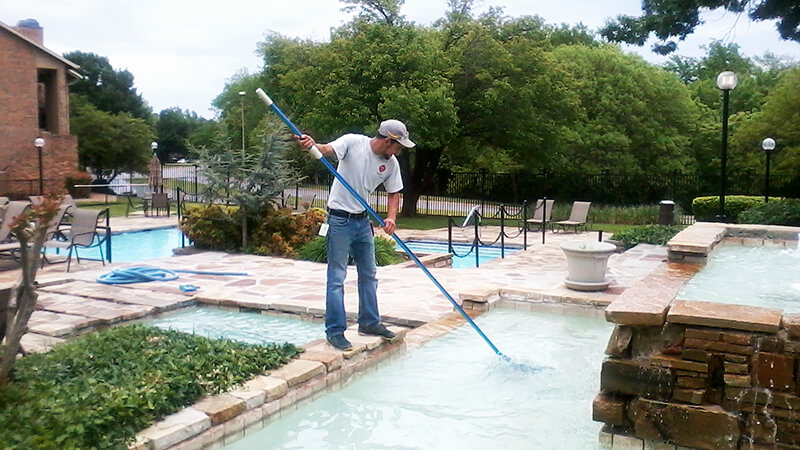 man servicing swimming pool